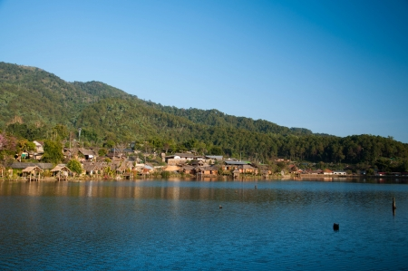 Chinese hill village by the lake view, north Thailand photo