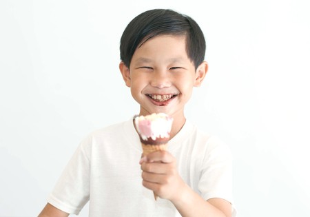 thump: Asian boy eating ice-cream in isolate background