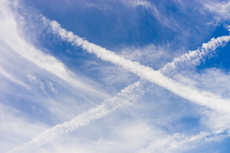 X cross cloud from Aircraft Condensation Trails (Contrails) on blue sky,Cross traces of planes on the blue sky