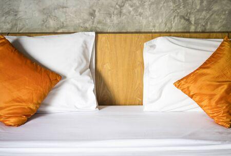 The mattress white.The Orange pillow