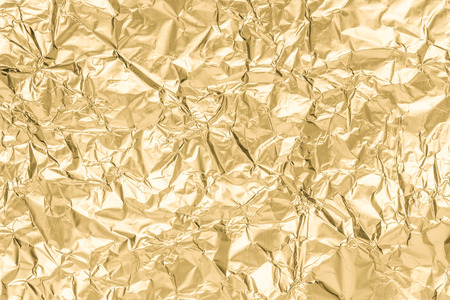 Gold wrinkled paper texture abstract background 免版税图像