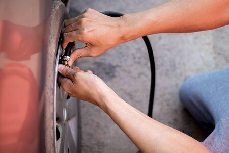 Close up hand of man inflating tire. Reklamní fotografie