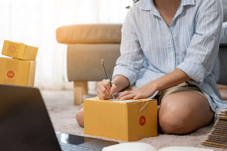 Small business entrepreneur SME or freelance Asian woman working with box at home Stock fotó