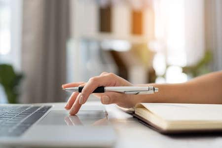 Close up women hand using laptop for work at home Reklamní fotografie