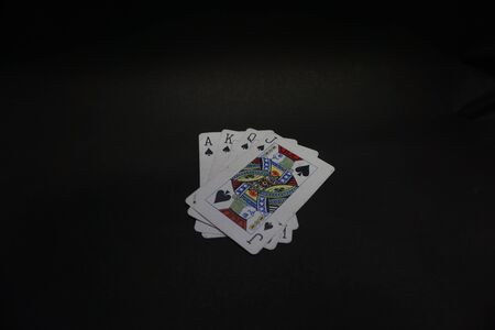 spade ace king queen joker playing card all together in black background