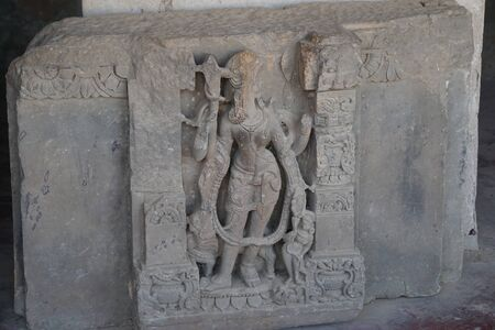 india - rajasthan - jaipur - dausa - march 28, 2018, archeological relics sculpture , broken face of lord shiva 스톡 콘텐츠 - 132970713