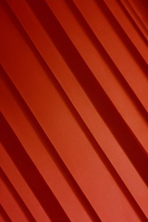A red background of red diagonal stripes.