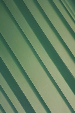 A green background of green diagonal stripes.