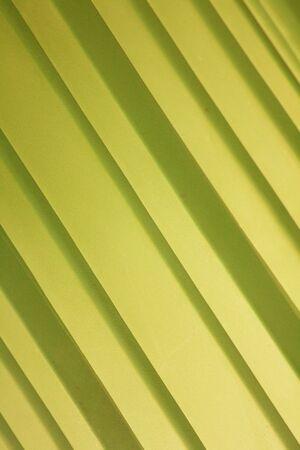A yellow background of yellow diagonal stripes.