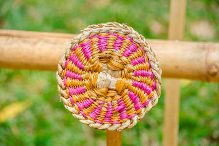 weaving: Abstract decorative wooden round striped textured weaving.