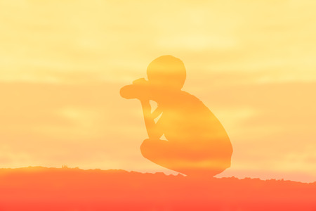 photography background: Silhouette of boy photography over sepia color style background.
