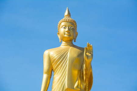 godhead: Standing Buddha status on the blue sky. Stock Photo