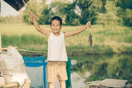Little Boy Catching a Fish. Kids Fishing.