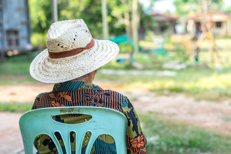 Elderly old woman on a chair with sad lonely. Stock Photo