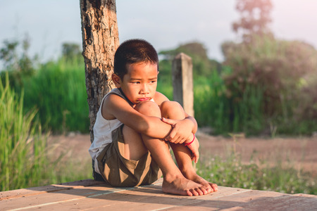 nuda: Little boy unhappy sitting alone on abandoned temporary housing. Reklamní fotografie
