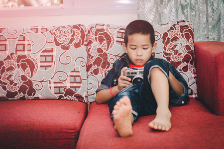 old school bike: Kid studying photography with old camera  favorite in the house.