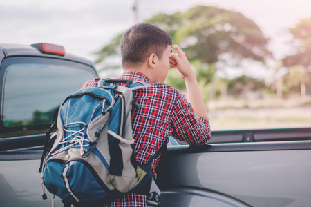 blind date: Young man hiker with backpack stood waiting friend,travel Concept. Stock Photo