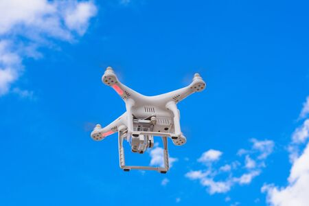 controlled: White drone, quadrocopter with photo camera flying concept on the sky. Stock Photo