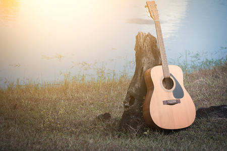 acoustic guitar background on riverside. Stock Photo
