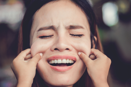 Kid Pinching cheeks mom,Funny face. Standard-Bild