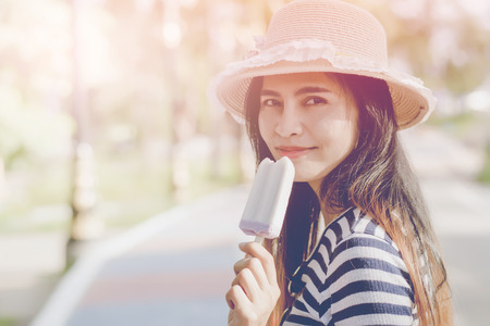 close-up portrait of young hipster woman eating ice cream in summer hot weather, have fun and good mood.