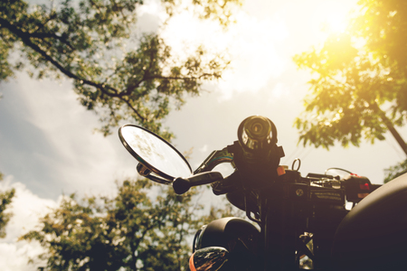 A motorcycle on nature park and sunset, select focusing background.