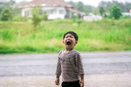 Child shouted on a rainy day.
