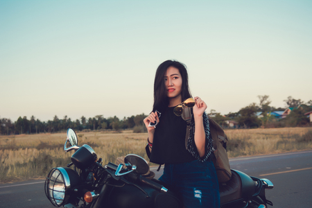 Young woman on a motorcycle in nature on the sunset.Travel Concept. Reklamní fotografie