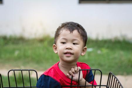 Happy children playing with a bike alone. 免版税图像 - 123508484