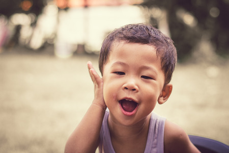 close up portrait of  a child boy smiling. 免版税图像