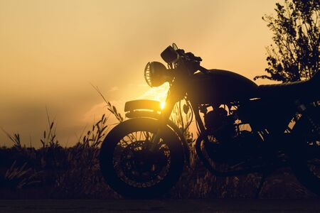 Cose-up silhouette of motorbike on sunset background,Enjoying freedom and active lifestyle. 免版税图像 - 138252214