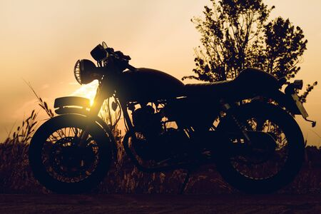 Silhouette of motorbike on sunset background,Enjoying freedom and active lifestyle.
