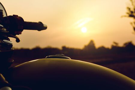 Cose-up silhouette of motorbike on sunset background,Enjoying freedom and active lifestyle.