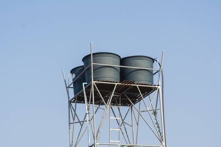 Water tanks on steel bar of rural village. 免版税图像 - 141698112
