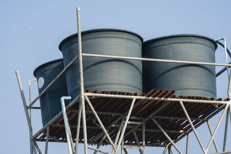Water tanks on steel bar of rural village. 免版税图像 - 141698049