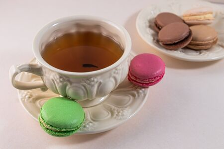cozy still life with a cup of tea with a saucer and macaroon pie