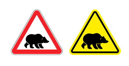 dangerous: Attention bear warning sign. Hazard yellow sign Grizzly. Silhouette of  terrible wild animal on red triangle. Set Road signs.