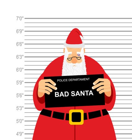 Mugshot is bad Santa. Arrested Sana Claus at  police station holding a sign. Christmas  offender in  bruise under eye. His grandfather was detained for fight.