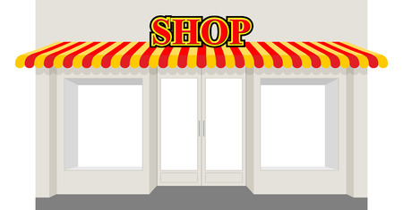 Store showcase. Facade of  shop building. Storefront with striped awning.