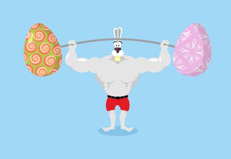バーベルとイースターの卵を保持強いウサギ。ウサギのスポーツ.伝統的なイースターの卵。ハッピー イースター。動物のボディービルダー