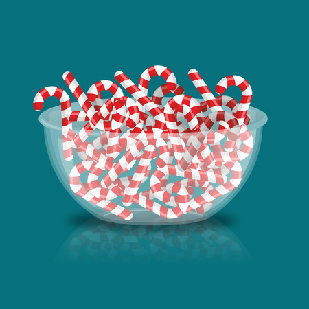 Mint Christmas candy in bowl. Peppermint stick deep in transparent plate. Sweets for New Year. traditional Lollipops for holiday