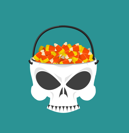 Happy halloween skull basket candy corn. Trick or treat. Sweets for terrible holiday. Horrible skeleton basket for sweets