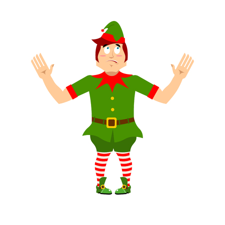 Surprised Christmas elf raised his hands to sides. Discouraged assistant of Santa Claus. wonderl at  little man in green suit. XMAS character for new year