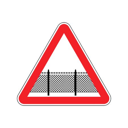 Warning sign attention with barbed wire fence. Note border on road. Road red symbol interdiction zone