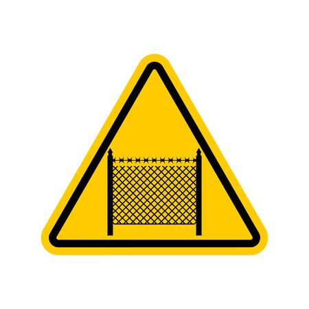 yellow beware: Warning sign symbol with barbed wire fence. Note border on road. Road yellow sign interdiction zone