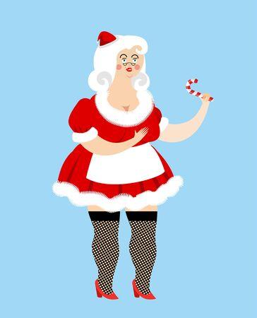 Señora Santa Claus y piruleta. Mujer de Navidad y mentas. femenino atractivo en el corto vestido rojo y sombrero de santa. Rubio traje de Año Nuevo. muchacha de navidad