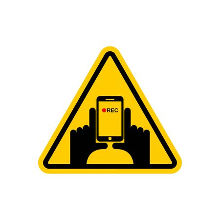 Attention Vertical video. Hand and smartphone to record. Road sign on yellow triangle. symbol Caution Illustration