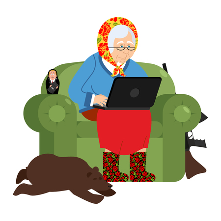 cyber woman: Russian hacker Grandmother and laptop. old woman in an armchair with bear. grandma from Russia in felt boots. Traditional national clothes