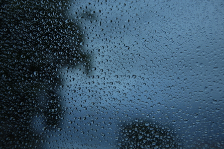 humid: water drops on glass.
