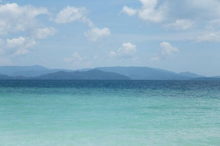 phangnga: Andaman Sea, emerald water, blue sky, beautiful clouds and mountains.